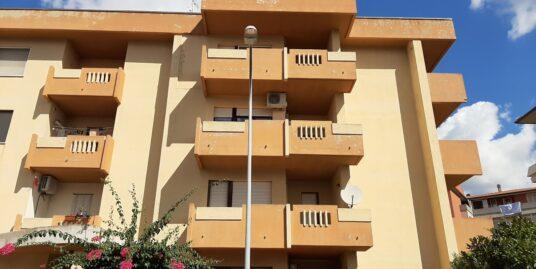 Appartamento quadrivano con balconi e posto auto